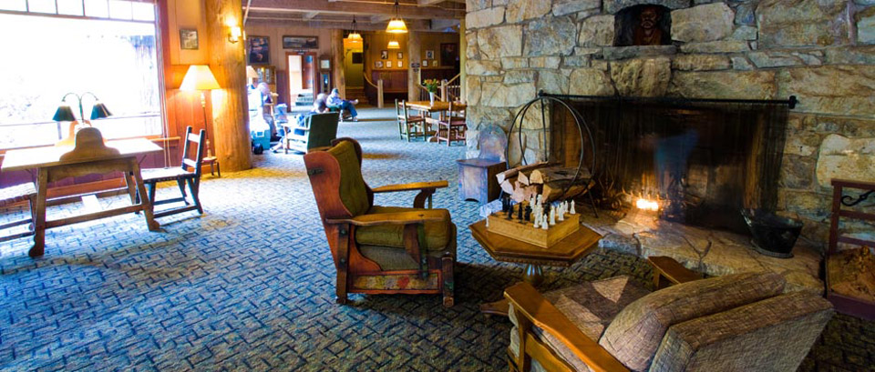 View of the Chateau main lobby featuring a fireplace and comfy chairs